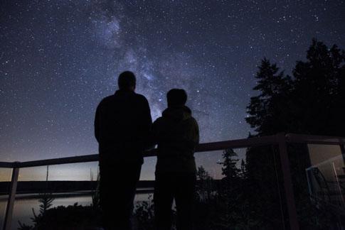 People looking at night sky